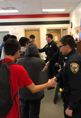 Police officers greeting students
