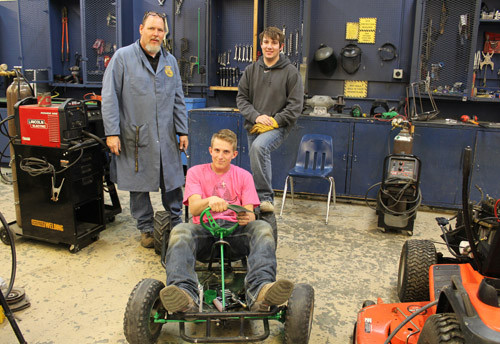 Students and teacher with go kart