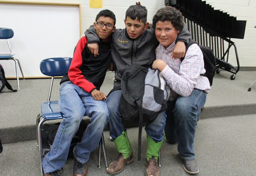 Three students hugging