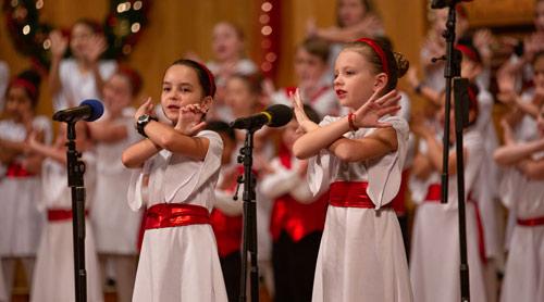 Two children singing