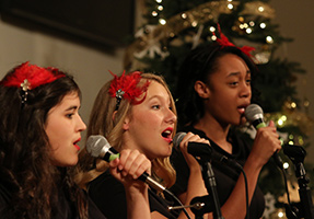 Three female choir members sing together
