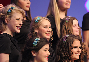 Female children's choir members pose together