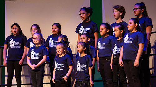 Group of children singing on stage