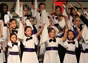 Prelude Choir children with handkerchiefs