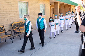 Young singers walking