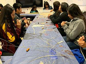 Students using hay as part of a classroom activity