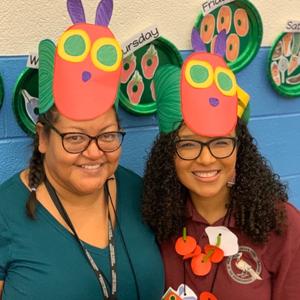 teachers with caterpillar hats