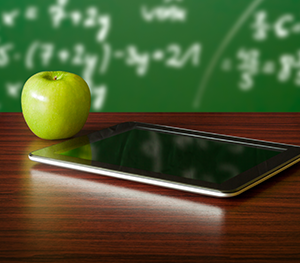 apple with tablet at desk