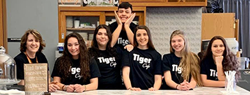 high school students with teacher at tiger cafe