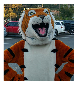 Capitan High School fighting tiger mascot outside posing for a picture