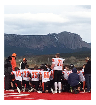 Capitan High School football players huddled up for a final meeting