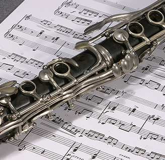Sheet of music with clarinet on top