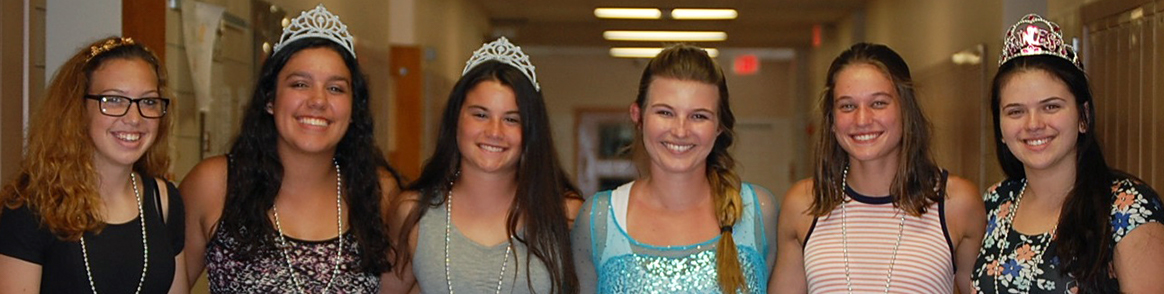 Group of Girls Dressed Up in Tiaras