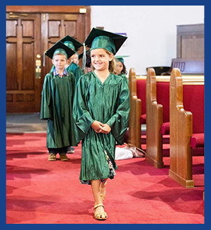 Happy graduate walking down the aisle during K-5 graduation