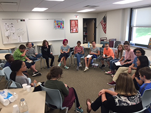 Students in the book club sit in a circle