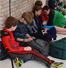 Students Sitting in Hallway