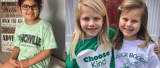 Smiling female student wearing a Branchville Elementary t-shirt and two female students pose together wearing shirts that read Choose Kind and Beaver Boogie