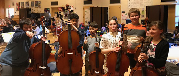 six elementary students holding their instruments