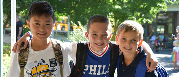 Three happy Veterans Park School students on the first day of school