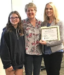 Nicole G and teacher Dawn Kawalicz and Pam Banks with award