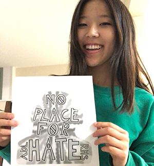 Student holdin No Place For Hate picture
