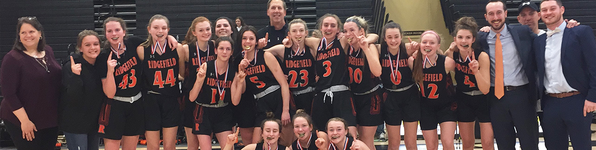 Group of happy Ridgefield HS girls with their coaches