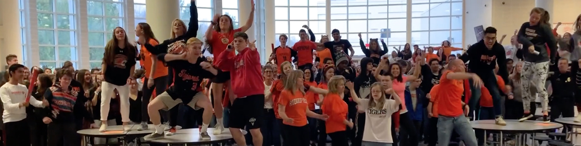 students dancing in the cafeteria
