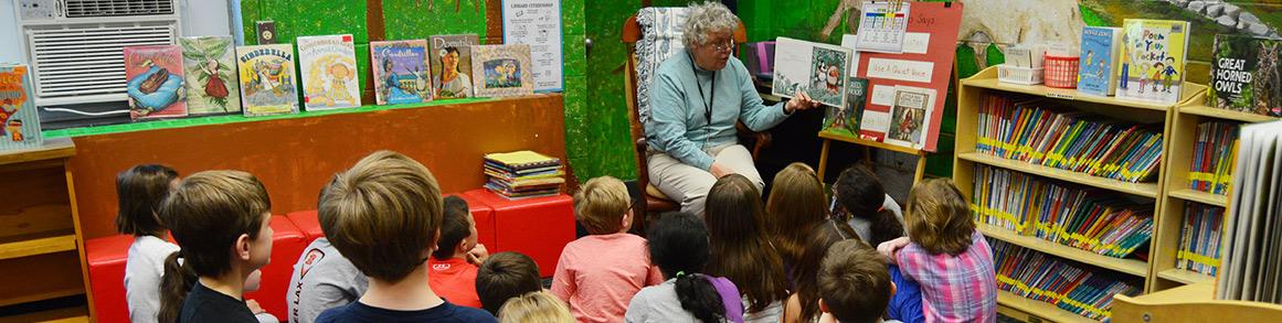 Teacher reading with children