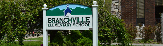 School sign and building