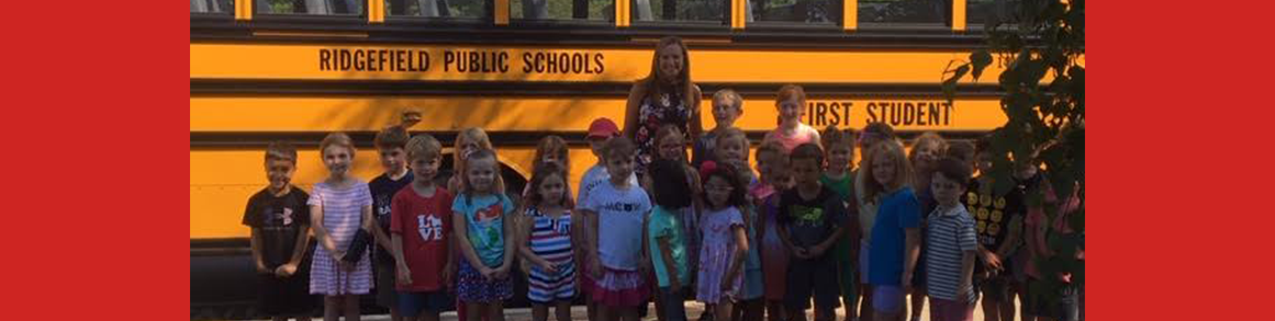Scotland principal and students in front of school bus at kindergarten orientation