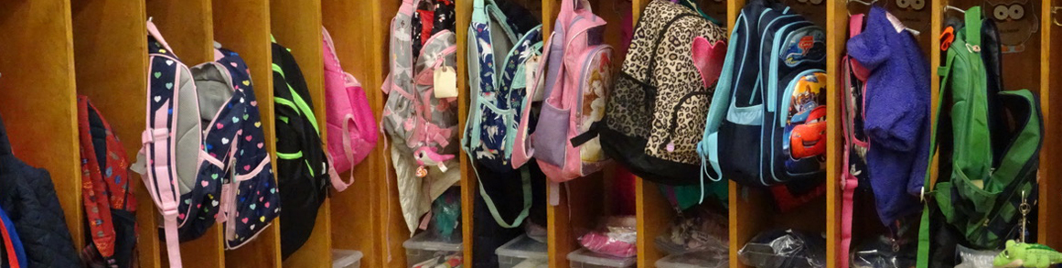 Students backpacks in cubbies