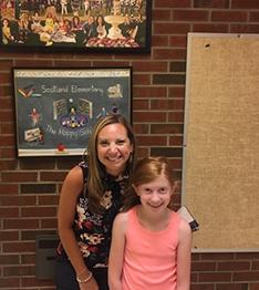 Scotland principal Jill Katkocin with 4th grade student Ava
