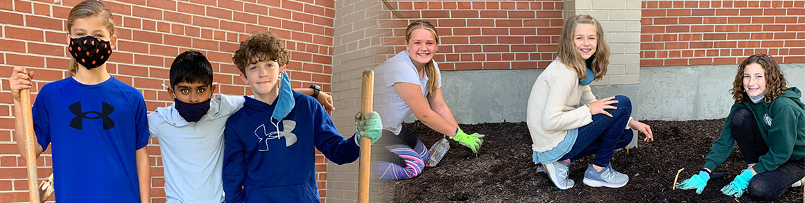 Male and female students planting in the dirt outside