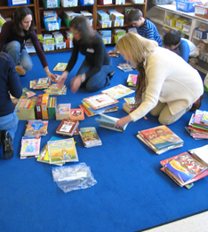 Staff members sorting books on the floor