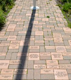Sidewalk bricks with etched words