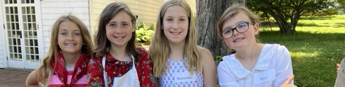 Students dressed in colonial attire pose together