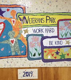 mosaic welcomes visitors and reminds students and staff to work hard and be kind