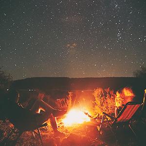 Campfire under a starry sky