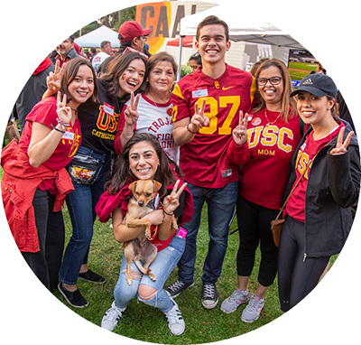 Group of friends wearing USC shirts and smiling