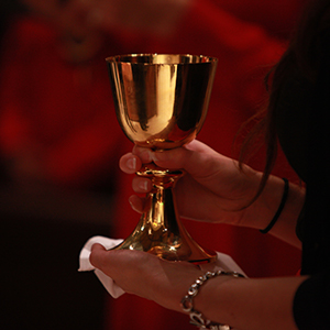 Hands holding a chalice