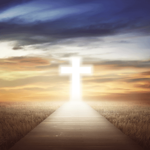 Glowing cross at the end of a walkway surrounded by fields and sky