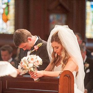 Praying bride and groom