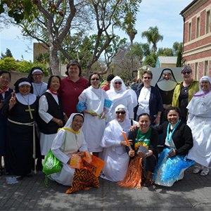 Nuns and staff members pose together outside