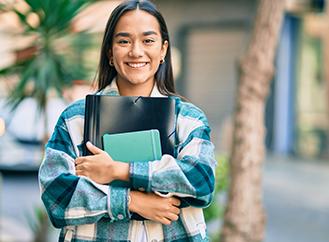 Confident Hispanic high school student ready for school