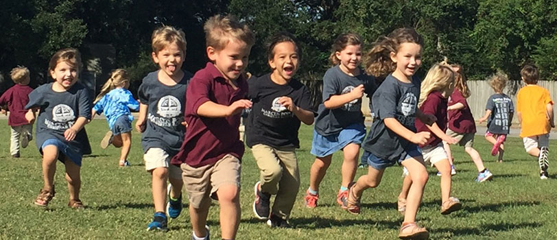 Group of kids running joyfully