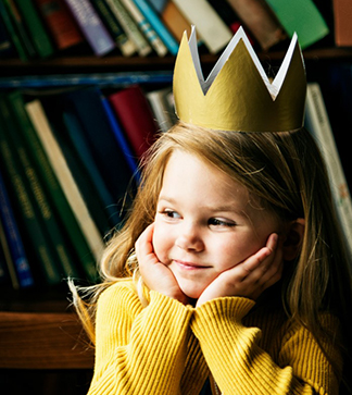 Female student wearing a crown looks off into the distance