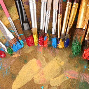 paintbrushes with colorful paint on them