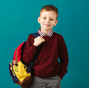 boy holding a backpack