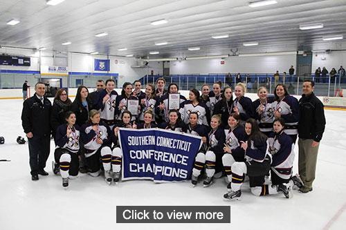 Girls hockey team and coaches