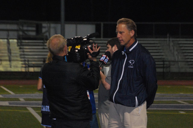 Coach Wilcox being interviewed by channel Fox 61